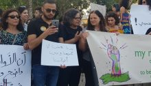 "MK Aida Touma-Sliman (third from left) during the Arab-Palestinian LGBT community protest held in Haifa last Thursday, August 1; the small sign in the center reads: ""We want to live within our society and according to our own wills."""