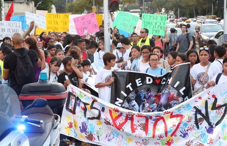 "Children and their Filipina mothers demonstrate in central Tel Aviv against their looming deportation from Israel, Tuesday, August 6. The Hebrew banner reads: ""No deportation of children."""