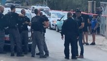 Police officers outside the home of Amina Yassin-Farhat in Jadeidi-Makr on Saturday, August 17, 2019