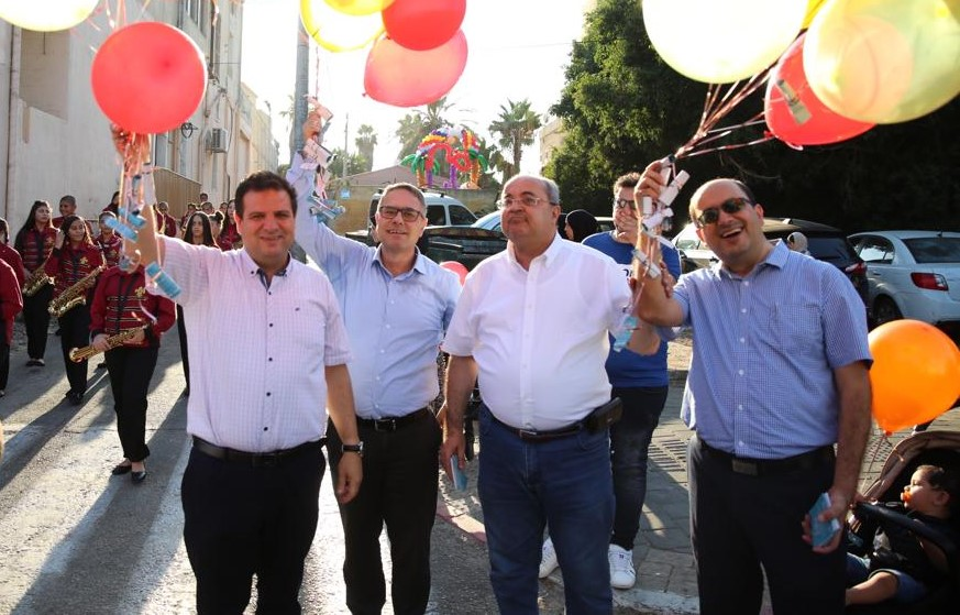 MK Ayman Odeh (first from left) with Joint List candidates Mtanes Shehadeh, MK Ahmad Tibi and Sammy Abu Shehadeh during a campaign tour in Jaffa during the recent Eid al-Adha festival