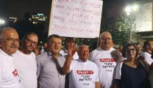 "Hadash MKs Ofer Cassif and Youssef Jabareen (second and third from left) and Teacher's Union activists from Hadash during the demonstration held in Tel Aviv, last Thursday night, August 29; the sign reads: ""*12,000 unemployed Arab teachers; *To earn a living, teachers who are mothers travel daily from the north to the south; *Let pensioners live with honor; *Make part-time jobs full-time."""