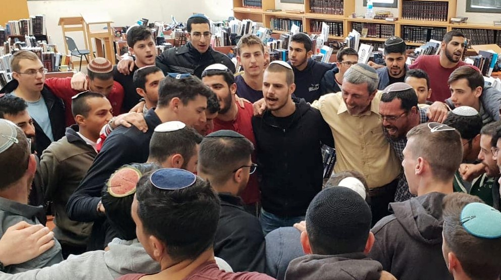 Current Education Minister Rafi Peretz (right, in the inner ring, dressed in a beige shirt) with Otzem Pre-Military Torah Academy students when he headed-up that school