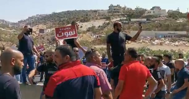 Protesters blocking the Wadi Ara road on Friday, September 27