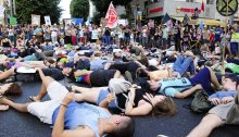 During the Friday, September 27, protest march in Tel Aviv, dozens of teenagers lay down on Allenby Street to symbolically depict humanity's fate unless the climate crisis is seriously addressed by governments and the economies around the work.