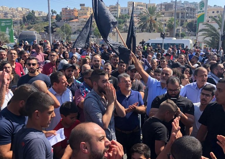 Protesters blocking Route 65 near the city of Umm al-Fahm, among them Hadash MKs Ayman Odeh and Youssef Jabareen