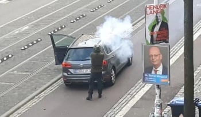 The 27-year-old neo-Nazi Stephan Balliet, recorded by a security camera on a street in the city of Halle in eastern Germany as he fires on passersby after he was unsuccessful in his attempt to break into a nearby synagogue with the intent of massacring worshipers there on the holiday of Yom Kippur, Wednesday, October 9