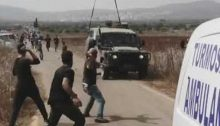 Following the Israel army's violent suppression of the initially peaceful protest near Turmus Ayya on Thursday, October 17, Palestinians hurl stones at a military jeep.