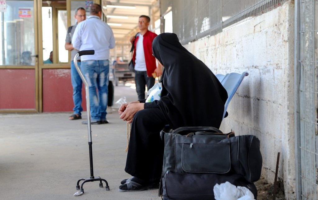 A woman waiting at the Palestinian side of Erez Crossing between Gaza and Israel