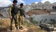Occupation soldiers standing on the periphery of the West Bank settlement Beitar Illit, which was partially built on land expropriated from the Palestinian village of Wadi Fukin