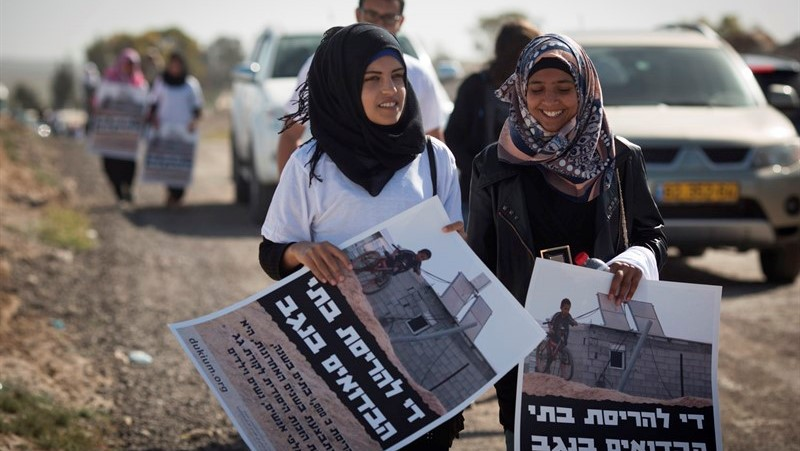 Arab-Bedouin teens marching to Jerusalem to protest the demolition of their communities' homes in the Negev