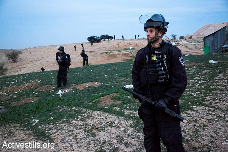Israel police officers armed with black, sponge-tipped bullets during the evacuation of the Arab-Bedouin village Umm al-Hiran, January 18, 2017