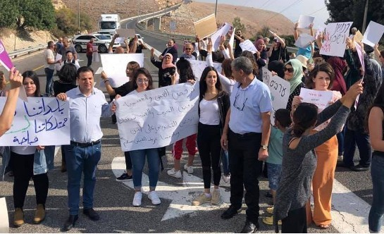 """Hadash activists and residents of the predominately Arab Akbara neighborhood in Safed demonstrated last Friday, November 1, against racism after fascists sprayed graffiti and vandalized Arab-owned vehicles in the in northern Israel community. The sign at the extreme left reads: """"Our towns and property are not lawless."""""""