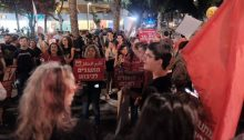 Demonstrators near the Likud headquarters in Central Tel Aviv Tuesday evening, November 12, brandish Hadash placards and call for an end to Israel's occupation of the Palestinian territories and a halt to its blockade of Gaza.