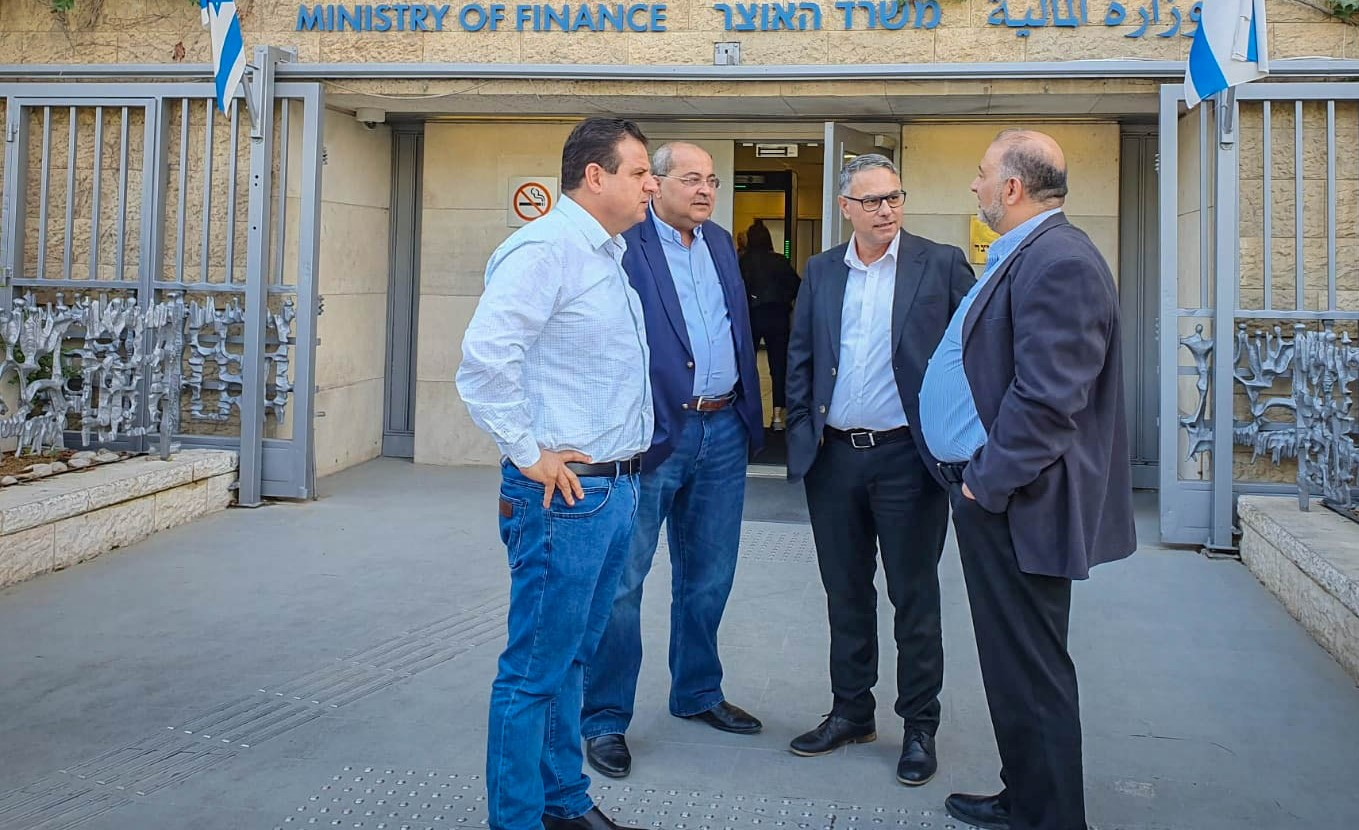Hadash's Ayman Odeh, Ta'al's Ahmad Tibi, Balad's Mtanes Shehadeh, and Ra'am's Mamsour Abbas, the leaders of the four parties comprising the Joint List, confer outside the Ministry of Finance in Jerusalem, October 2019.