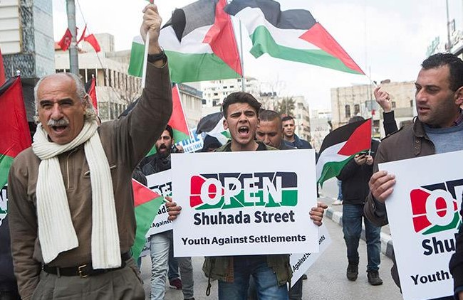 Palestinians demonstrate against the Jewish settlement in Hebron.