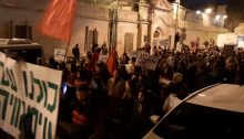 "Hundreds of Israeli and Palestinian activists demonstrate outside police headquarters at Jerusalem's Russian Compound on Saturday night, December 7, in solidarity with the residents of Isawiya. The large banner at the extreme left reads: ""We are all with Isawiya."""