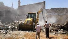A bulldozer, commissioned by the Israel Land Administration demolishes the foundations of the Adassi family's home in Ajami, an Arab neighborhood in Jaffa.