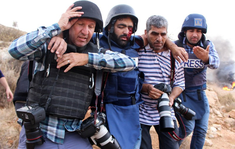 Palestinian photojournalist Moath Amarneh was seriously injured while covering protests in Surif, near the West Bank city of Hebron, November 15, 2019.