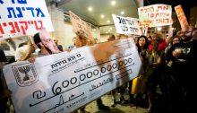 During a demonstration against the privatization of natural gas found in the Mediterranean Sea off the Israeli coast, protesters outside the home of the then Energy Minister, Silvan Shalom, hold up an oversized check (pun absolutely intended) from the State of Israel to Israeli tycoon Yitzhak Tshuva with the estimated value of the natural gas to eventually be produced from the Leviathan offshore natural gas field, May 11, 2013.