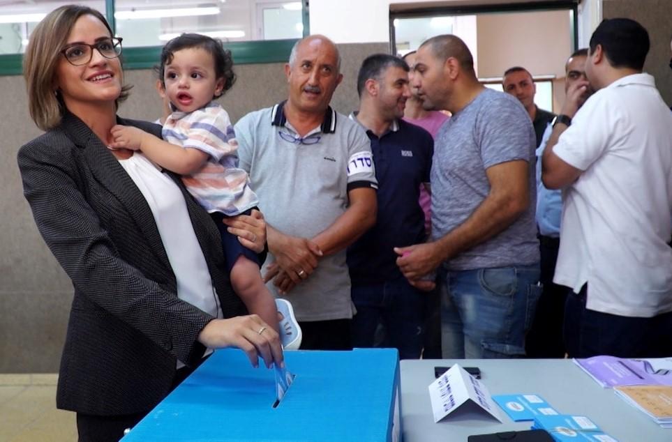 MK Heba Yazbak voting in last September's election