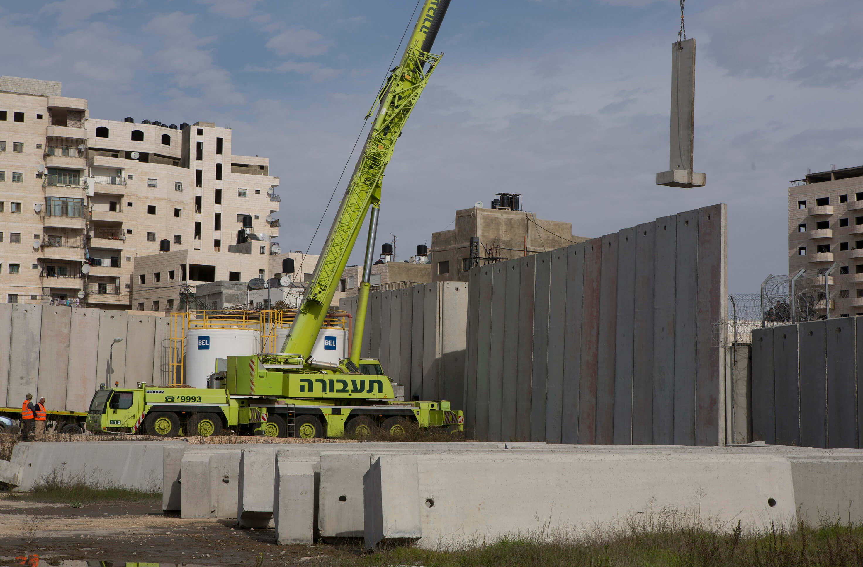 Capital and Rule: Heavy equipment belonging to Taavura, the largest road haulage and logistics company in Israel, works on the expansion of a checkpoint at the Shuafat refugee camp in occupied East Jerusalem, June 2014.