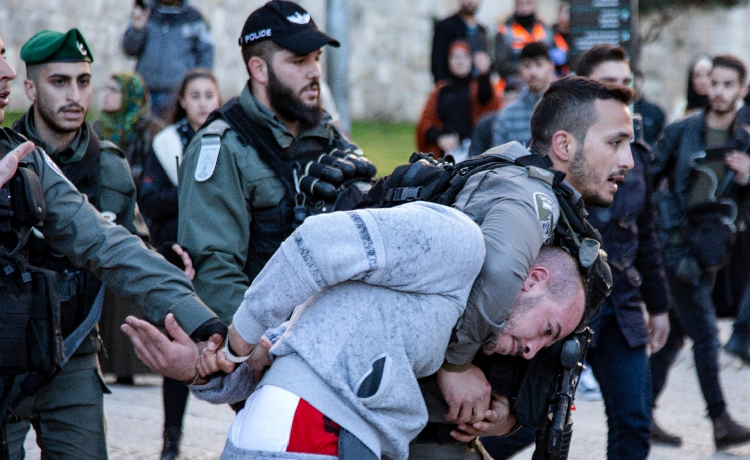 "Israeli police forces suppress a protestor demonstrating against the Trump administration's plan, Jerusalem, January 29, 2020. Clashes have been taking place in the West Bank since the US announced its so-called ""Deal of the Century"" on January 28."