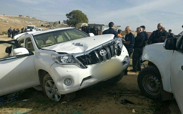 Israeli police stand next to the vehicle belonging to Yaqoub Mousa Abu al-Qee'an that rammed into officers in the Arab-Bedouin village of Umm al-Hiran in the Negev desert, January 18, 2017.