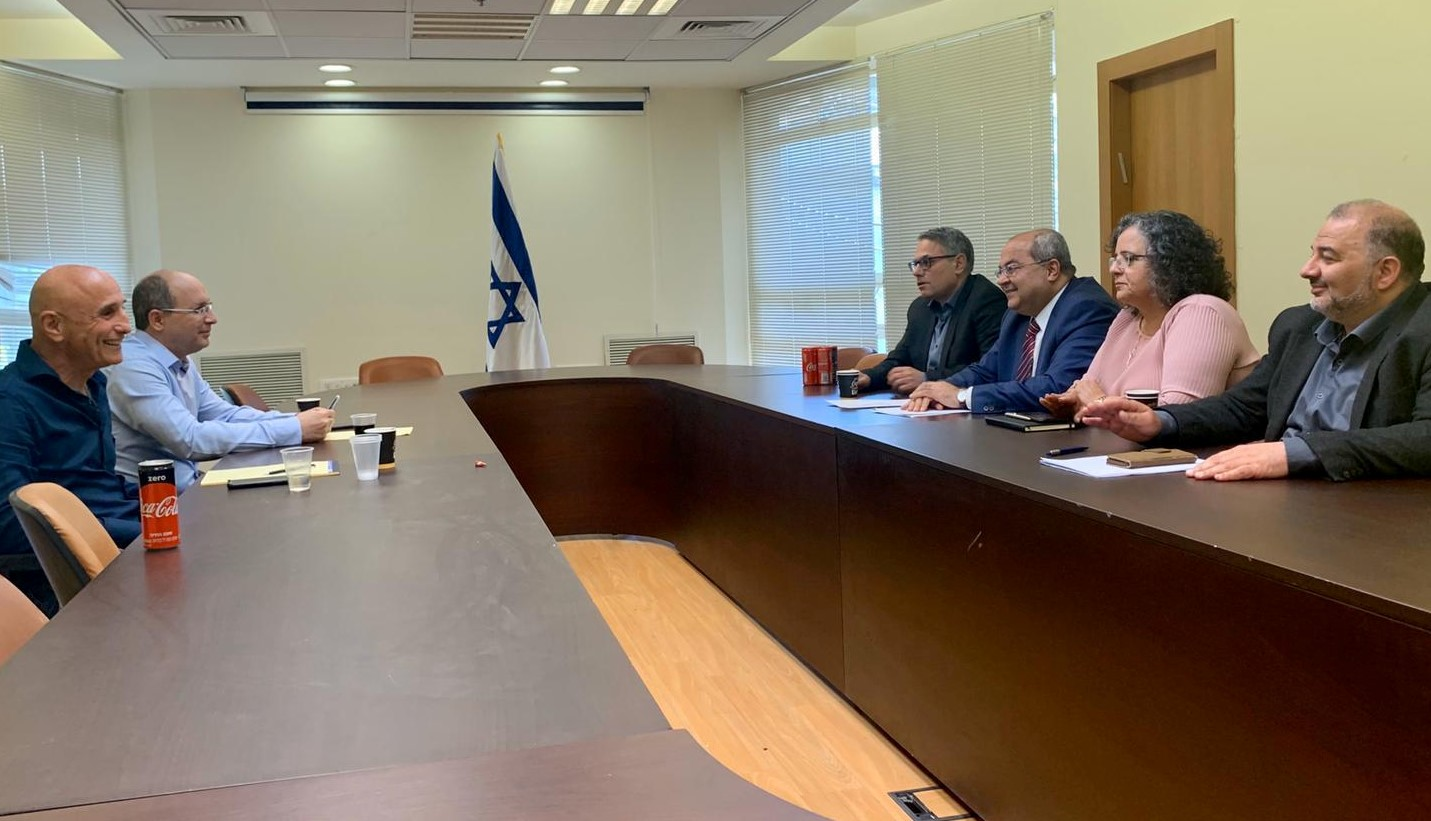 Senior lawmakers from Blue & White, MKs Ofer Shelah and Avi Nissenkorn (left) met with their counterparts in the Joint List on Wednesday MKs Mansour Abbas, Aida Touma-Sliman, Ahmad Tibi and Mtanes Shihadeh, in the Knesset, March 11, 2020.