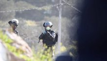 Israeli forces fire at Palestinians on Jabal al-'Arma, last Wednesday, March 11.