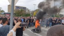 El Al workers demonstrate near the company's headquarters at Ben Gurion Airport after the company announced massive layoffs, Thursday, March 12, 2020.