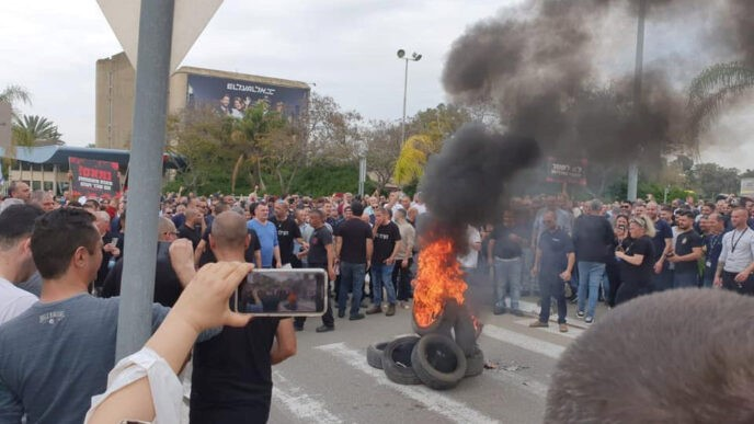 El Al workers demonstrate near the company's headquarters at Ben Gurion Airport after the company announced massive layoffs,Thursday, March 12, 2020.