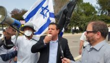 Hadash MKs Ayman Odeh (center) and Ofer Cassif (right) during the demonstration held on Monday in front of the Knesset against the far-right government's anti-democratic actions