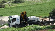 Crimes against humanity: One of two flatbed trucks sent by Israel's Civil Administration to confiscate tents and building materials that were to used to protect residents from the village of Khirbet Ibziq from the spread of COVID-19, Thursday, March 26, 2020
