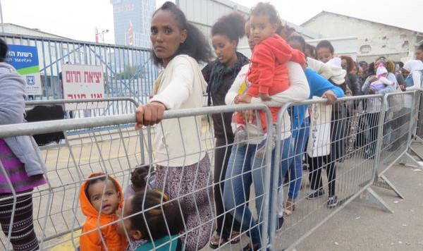 Asylum seekers line up outside Ministry of the Interior facilities in Bnei Brak