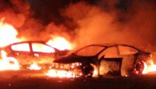Two cars belonging to Palestinians that were firebombed by settlers near the Dead Sea overnight Monday, April 13