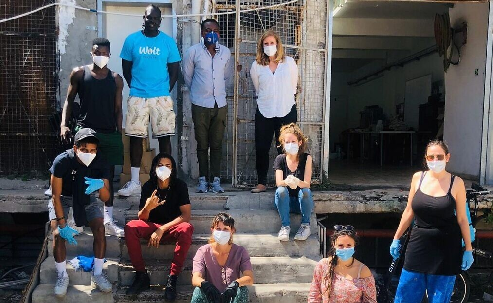 Volunteers with the African Refugee Development Center prepare to deliver food packages to African asylum seekers in south Tel Aviv, April 3, 2020.