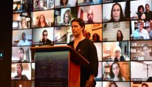 Bereaved Israeli family member, Tal Kfir, speaks during the joint Israeli-Palestinian Memorial Day ceremony broadcast from Tel Aviv on Monday evening, April 27.