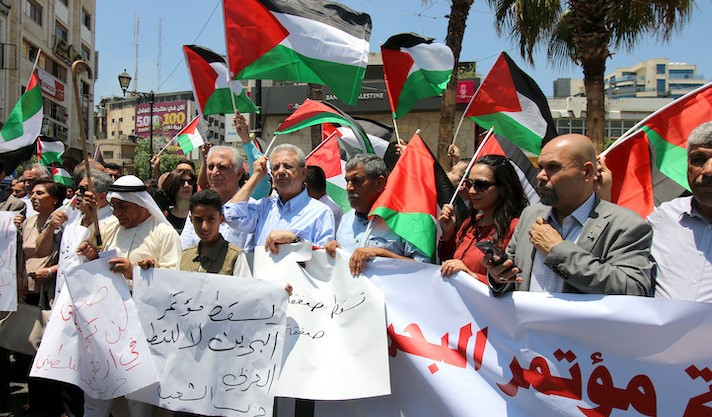 """Palestinians in Ramallah protest the Trump administration's """"Deal of the Century,"""" June 15, 2019. (Photo: Activestills)"""