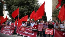 Members of Hadash and the Communist Party of Israel protest near the Knesset, on Thursday evening, May 14.