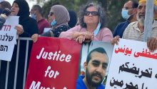 Abir Younis, the mother of Mustafa (at extreme left with microphone), and MK Aida Touma-Sliman (third from left) during the protest held Monday, May 19, at Sheba Hospital