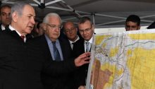 Prime Minister Benjamin Netanyahu, left, US Ambassador to Israel David Friedman, center, and then-Tourism Minister Yariv Levin (right – today, Speaker of the Knesset), during an on-site meeting to discuss mapping Israel's annexation of areas of the occupied West Bank, held within in the settlement of Ariel, February 24, 2020