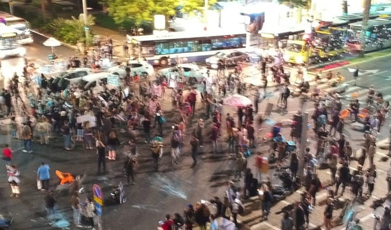 Demonstrators block the intersection of Ibn Gabirol Street and King David Boulevard, adjacent to Rabin Square in central Tel Aviv, Thursday evening, June 4. Police forcibly cleared the road while arresting 12 persons.
