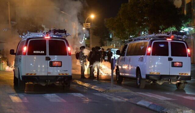 Police are deployed in the streets of Jaffa against demonstrators protesting the decision to demolish an historic Muslim cemetery in the city, June 10, 2020.