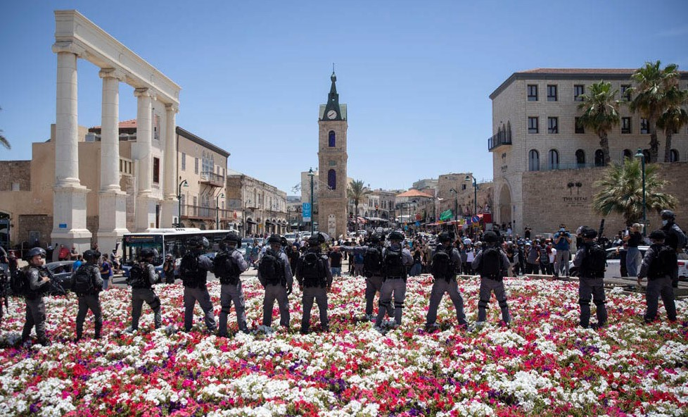 Police are deployed against demonstrators protesting the decision to demolish the ancient cemetery in Jaffa, June 12, 2020