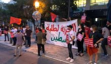 "Hadash students, activists, and lawmakers demonstrate in Jerusalem on Monday evening, June 22, in solidarity with Palestinian students in the occupied territories. The large white banner reads: ""Freedom for the Students of Palestine."""