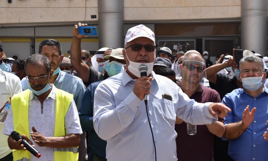 Head of the High Follow-Up Committee for Arab Citizens in Israel, Mohammad Barakeh (center), addresses the protesters gathered in Be'er-Sheva last Monday. At the extreme right of the picture is Hadash MK Yousef Jabareen and next to him MK Ofer Cassif.