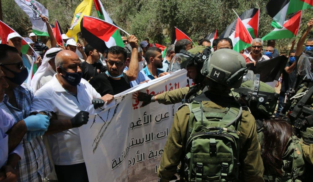 On June 13, Palestinians protested at the entrance to the village of Az-Zubeidat in the Jordan Valley against the US-Israeli annexation plan that is expected to take effect on July 1.*