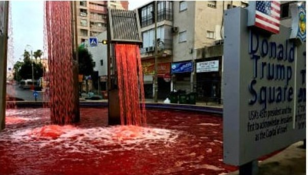 "Peace activists turned the water in the fountain at Trump Square red in the Israeli city of Petah Tikva on Monday, June 29, to protest the Netanyahu government's intention to annex parts of the West Bank. Graffiti scrawled at the base of the fountain read ""Annexation will cost us blood."""