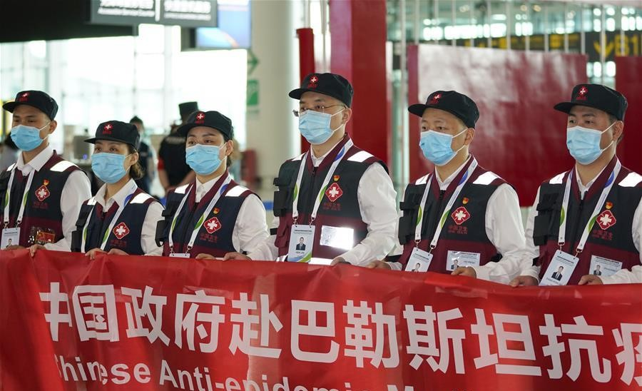 Members of a Chinese anti-epidemic expert medical team to Palestine attend a departure ceremony at Jiangbei International Airport in Chongqing, southwest China, Wednesday, June 10, 2020, just prior to its departure for Palestine. The team, organized by China's National Health Commission, left Chongqing for Palestine, where it helped Palestinians in the West Bank in their fight against COVID-19, and returned to China on June 18, after having successfully completing its mission.