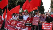 "Members of Hadash and the Communist Party of Israel demonstrate against the annexation and occupation of the Palestinian territories outside the Knesset, May 14, 2020. First from right is MK Ofer Cassif, whose Hadash sign reads ""Opposing the Occupation."""